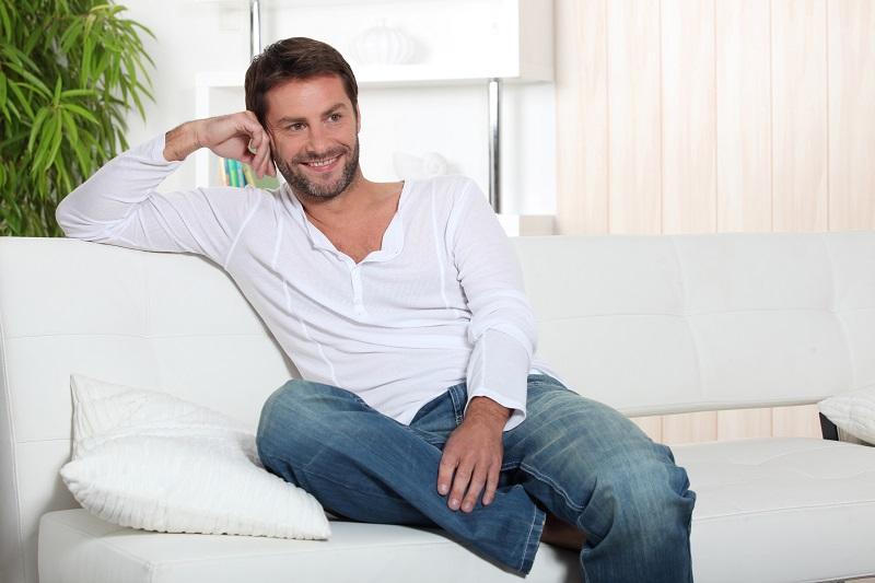 man relaxing in living room summer