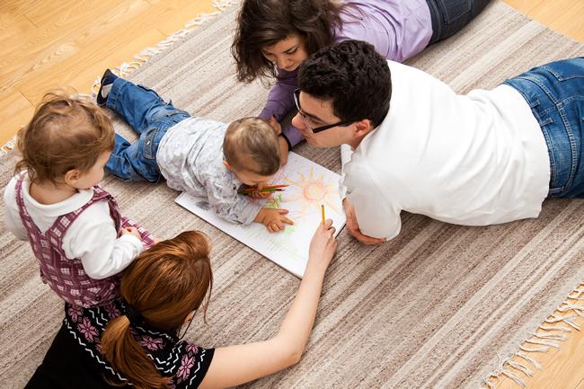 Family enjoying amazing benefits of fully functioning air conditioning system