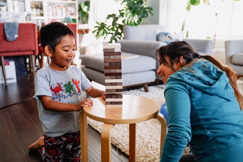 Mom and child playing jenga.